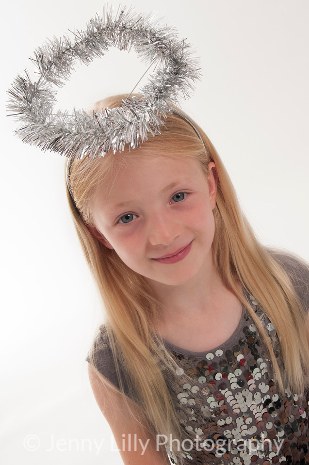 pretty blonde girl with a tinsel halo, isolated on white background