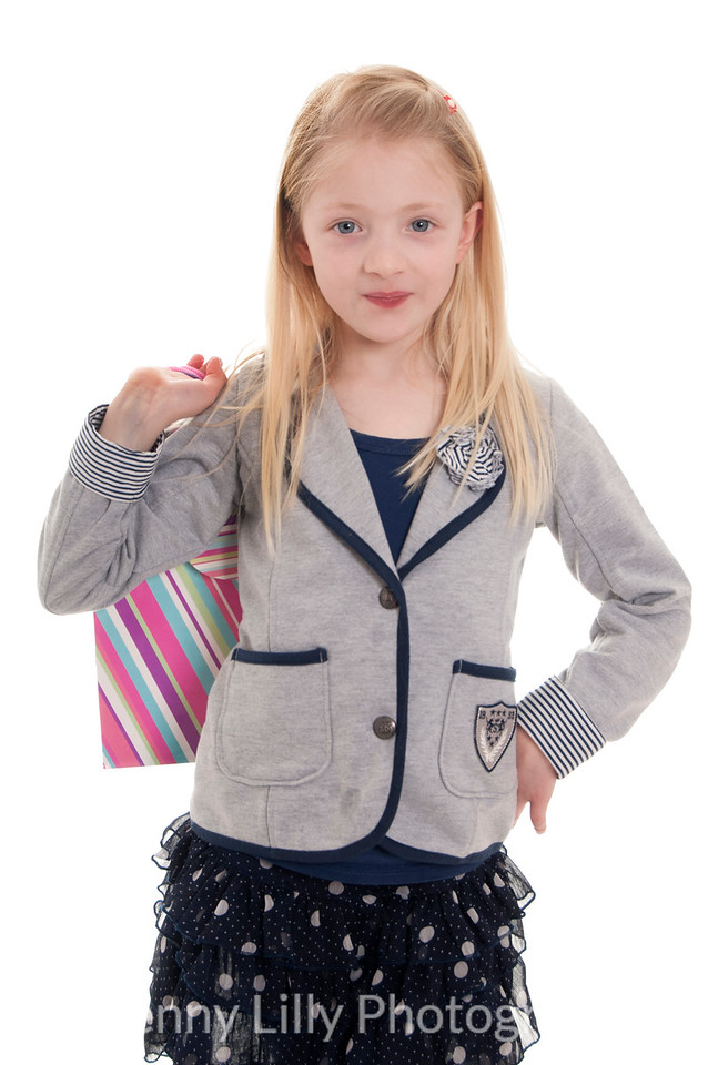 pretty blonde girl with shopping bags and bags of attitude, isolated on white background