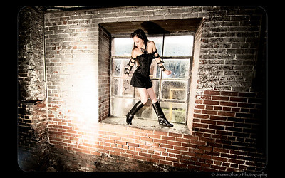 Angela enjoyed posing by the big square window at Sloss Furnace in her black mini and corset.