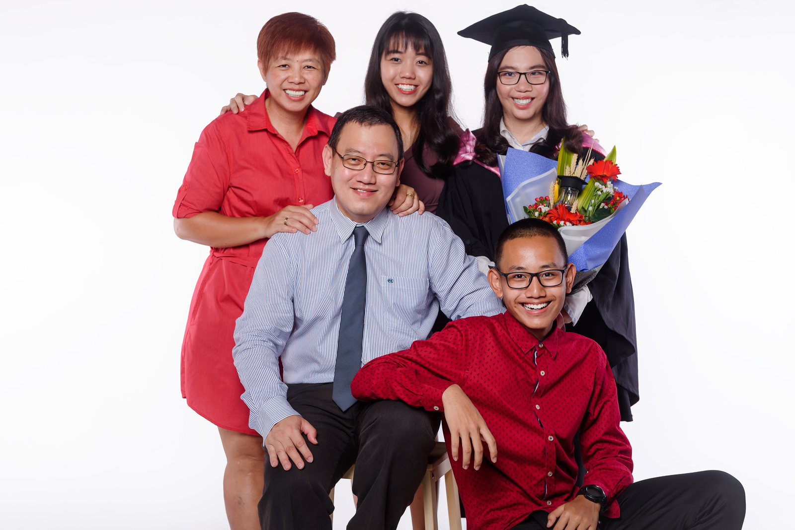 convocation student with family portraits
