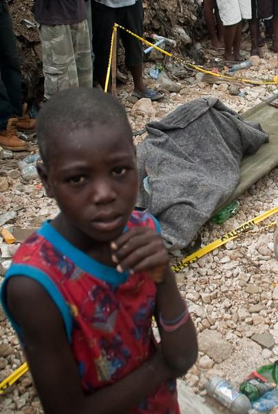 Behind him lies his grandmother, Port-Au-prince, Haiti, June 2011.
