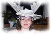 It has been our family tradition on New Year's Eve to create paper hats for ourselves out of newspaper and other assorted materials.  This is my daughter, Heather, with her creation one New Year's Eve.