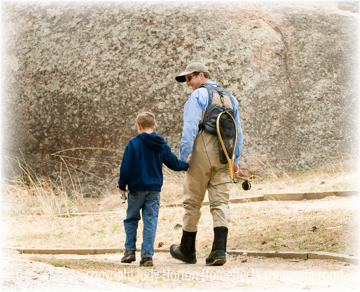 A boy and his dad return from a fly fishing experience; the detail in this image is best viewed in a larger size.