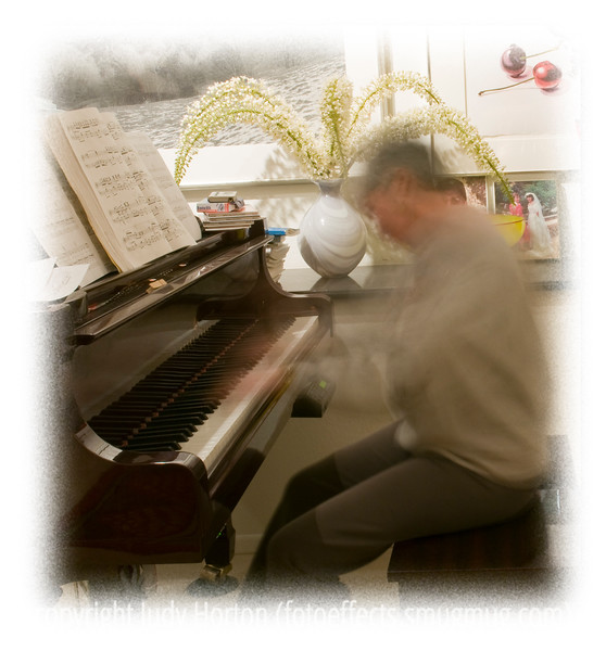 A picture of me practicing the piano; my goal with this self-portrait was to capture the motion of playing.
