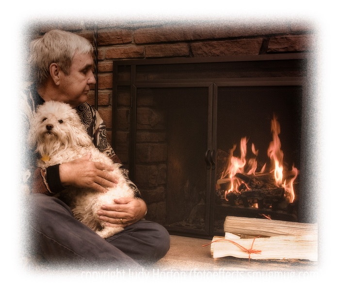 My hubby, Phil, and one of our dogs, Buckwheat, a cockapoo, enjoy the fire on a cold night.