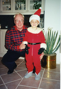 Jack with grandson Kendall dressed up as Santa's helper, Christmas Eve 1996