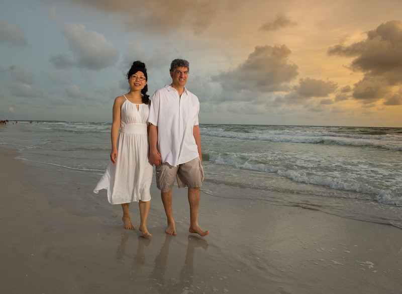 David and Jackie walking along Passe Grille Beach during sunset.