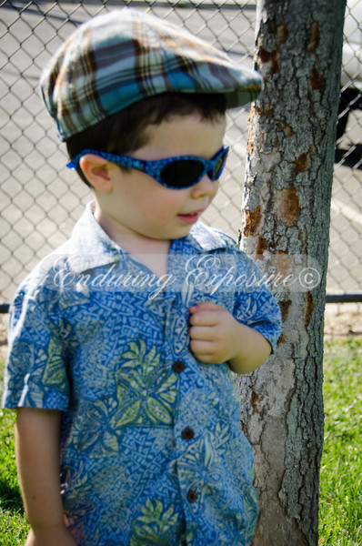 Promising young child model, Noah strikes a pose next to the tree.