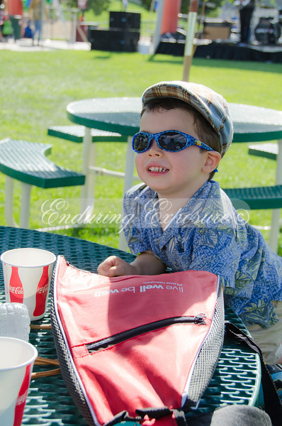 """Noah watching the """"big kids"""" yakking away on the other side of the table. He's apparently quite the people watcher."""