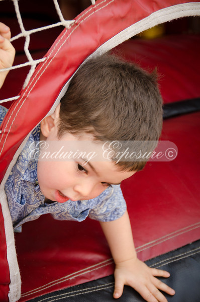 Noah in the jump house at Raley Field