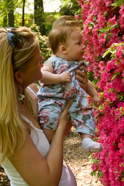 Laura Foose  of Potomac holds 3 1/2 month old Laila up for a closer look at the bright colors.