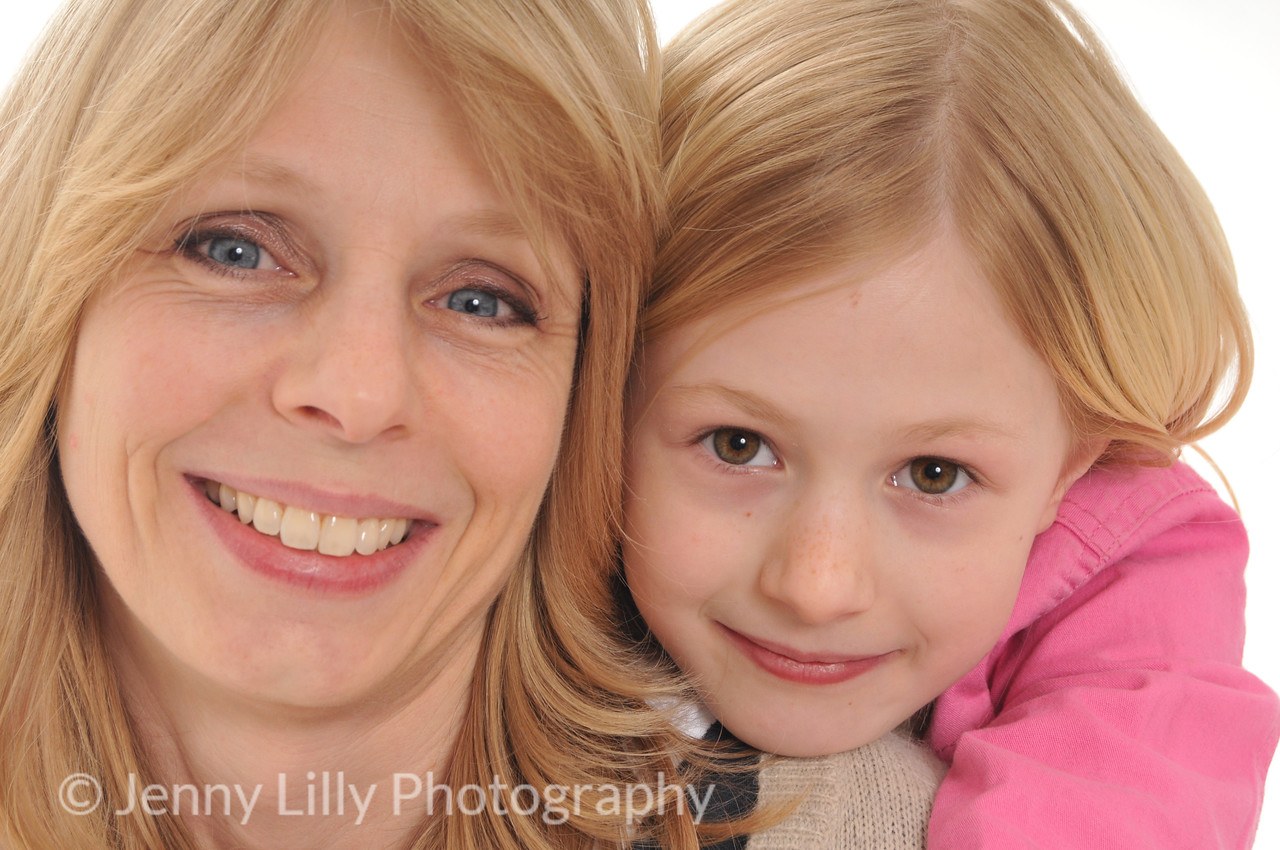 pretty blonde woman and her pretty blonde daughter, cuddling, isolated on white background