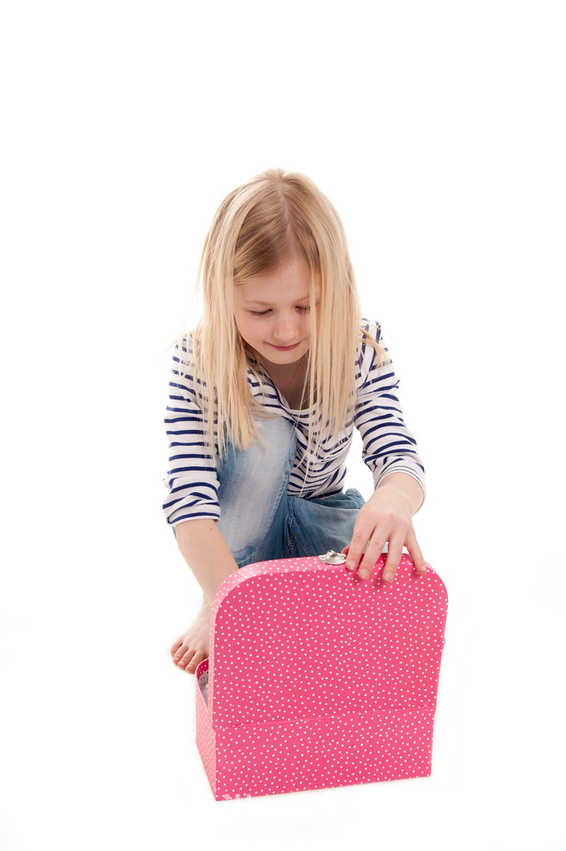 pretty blonde girl with her pink  suitcase isolated on white background