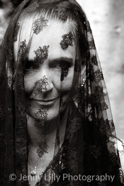 widow in mourning with veil over her face in monochrome