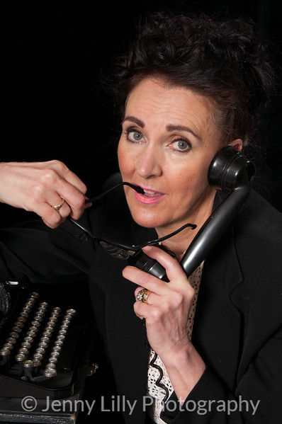 Vintage 1940's style woman in office situation, angry on the telephone, isolated on black background