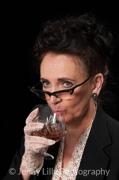 Vintage 1940's style woman in office situation,enjoying a drink, isolated on black background