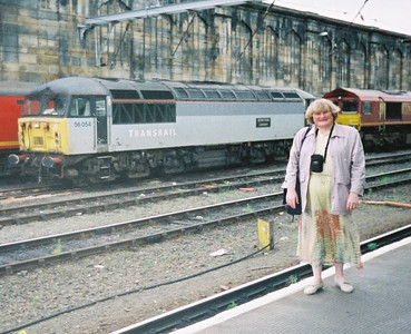 13 - My partner thought this was funny: me on Carlisle Station in the nearly 2000s with a Transrail liveried locomotive behind.