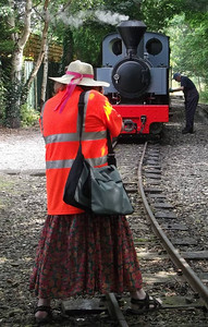 39 - the only shot Stephen took of me at the West Lancashire Railway on Saturday 11th August. Thankfully it shows my better side as I point my camera at Joffre. A fetching combination of multi coloured skirt and hi-vis polo shirt as I straddle the running line to get the shot. I need to trim the ribbon on my hat a bit as well. As has happened before, the bright orange shirt has done strange things to Stephen's camera.