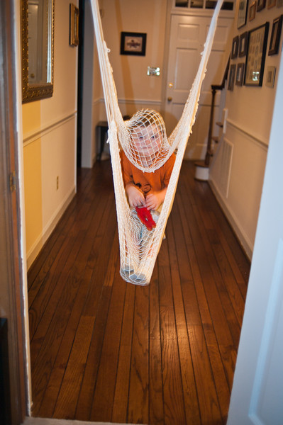 Vincent in his doorway hammock swing.  I wish I had one of these.