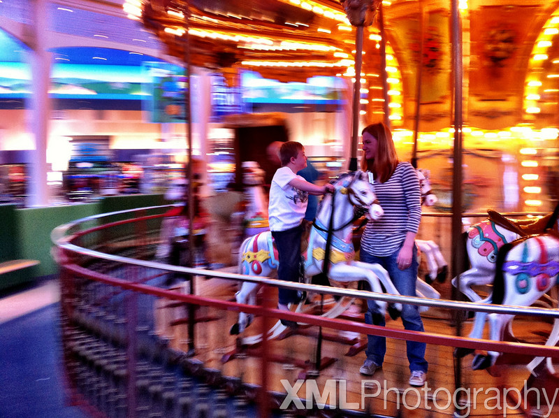 Vincent and Marisa on the carousel at Discovery Mills