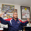 Frank Mastrangelo, an athletic director at Lawrence Academy in Groton, a resident of Shirley MA. and former runner of the Boston Marathon, talks about being a part of the medical team at least year's marathon in his office at Lawrence Acadeny on Monday morning. Framed on the wall behind him in his office is all the stuff he wore at the tragedy last year  SENTINEL & ENTERPRISE/JOHN LOVE