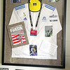 Frank Mastrangelo, an athletic director at Lawrence Academy in Groton, a resident of Shirley MA. and former runner of the Boston Marathon, was a part of the medical team at least year's marathon and framed on the wall  in his office is all the stuff he wore at the tragedy last year.  SENTINEL & ENTERPRISE/JOHN LOVE