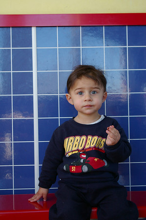 This is one of my top three favorite photos of Zain.  The wall makes his eyes look so blue, and his expression looks so mature! 1/16/9