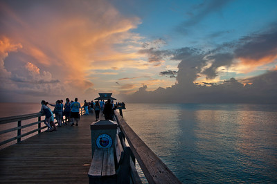 Pier and visitors at sunset
