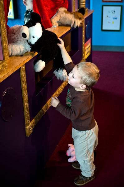 Trying to steal the puppet off the puppet stage (Milwaukee museum). - Owen - Dec 2008