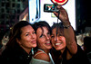 Self portrait of mother and daughters at Times Square.