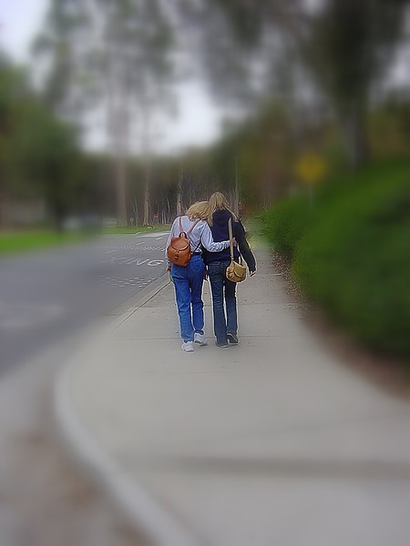 A mom walking her only daughter off to first day of college. Who is going to miss who?