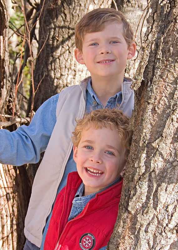 Erik and Jacob - We set out to photograph my handsome boys during the colorful Alaskan fall of 2005.  Erik is 7 and Jacob is 4.  I was working with portable off camera flash to help eliminate the strong sun.  Here, both boys were in the shade provided by the large Cottonwood tree trunks, but the flash helped fill the exposure.  This was the best of a large number of photos taken in  various locations around Cheney Lake.
