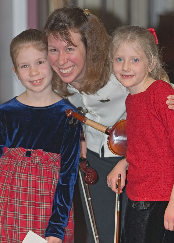 Emily, Sarah (Emily's mom) and Katie give the camera a big smile during the Chugiak Senior Center recital - Christmas 2005. Chugiak is just down the road from Eagle River, Alaska.