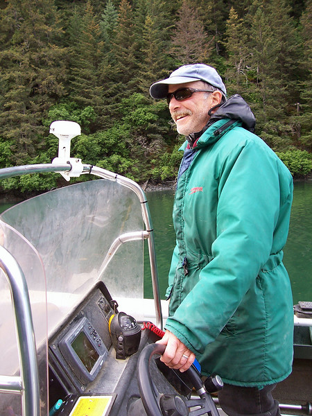Jim Lavrakas (Anchorage Daily News photographer) pilots his boat the 'Cliffhanger' in Jakalof Bay, Alaska.