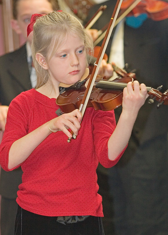 This beautiful young lady is Katie, the daughter of one of our family's dearest friends plays her violin during the 2005 Christmas recital at the Chugiak Senior Center in Alaska. This photo was taken from across the room, my camera on a tripod, with on camera flash (380ex), and the wonderful, sharp 70-200mm non-IS f2.8 L Canon lens.