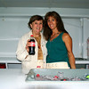 RUSSELL L. FRAYRE<br /> 8711<br /> Since 1985, Mary Daly of Cotuit has volunteered at the Pops Concert. Here she poses with her daughter Deb Hutchins of Marstons MIlls.  Mary and Deb man the Coca Cola booth. All proceeds  are donated to the Arts Foundation of Cape Cod.  Coca Cola Bottling Co Of Cape Cod Inc in Sandwich, MA donates the soda.