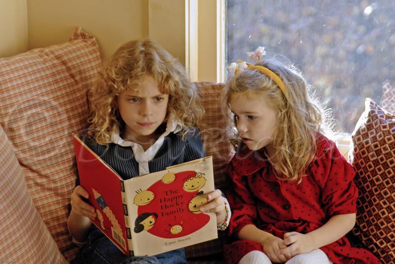 Cousins sharing a read.