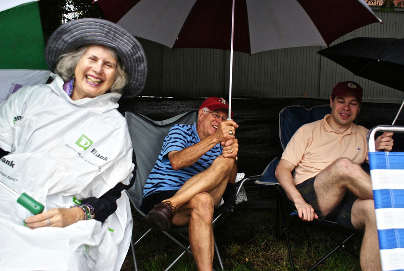 RUSSELL L. FRAYRE<br /> 8711<br /> Rosalind Roseinmann of Hyannis share a fun moment at the TD Bank Pops by the Sea concert with her new friends vacationing here fron New York, Mike and Chris Wolyniak