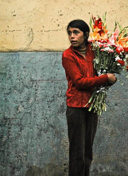 Gilr selling flowers, Lima, Peru, 2010.