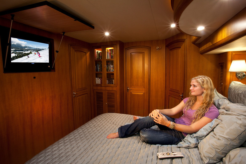 Photos of people watching TV on a Yacht