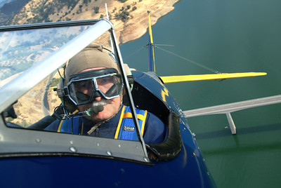 Retired Judge Polly practicing stunts in his 1943 Stearman biplane near Sonora, Ca.