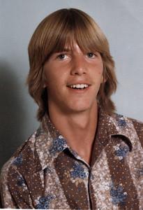 Ken in brown shirt
