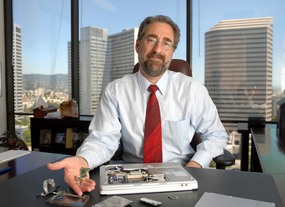 Attorney with his ruined computer which he says federal officials destroyed during his case against the U.S. Government.