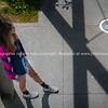 Teenage girl below standing leaning against post Model Released; Yes.