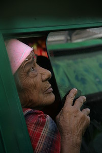 Old woman looking out the bus window