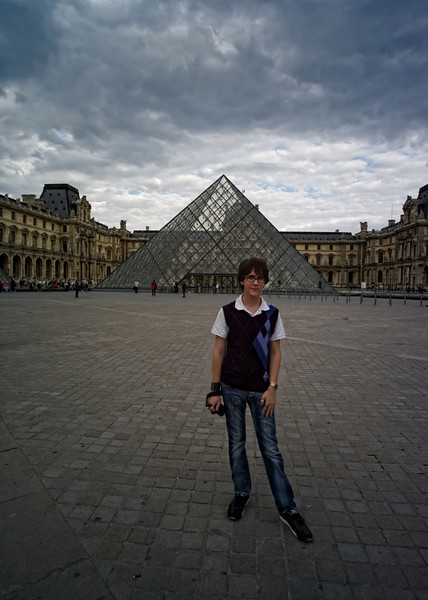 Adam strikes a pose at the Louve in Paris.