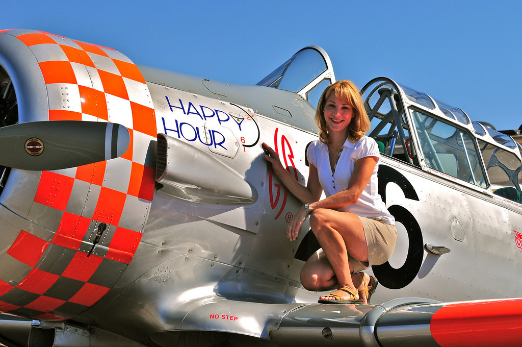 Outdoor portrait while perched upon the wing of a racing airplane. National Air Races, Reno, NV.