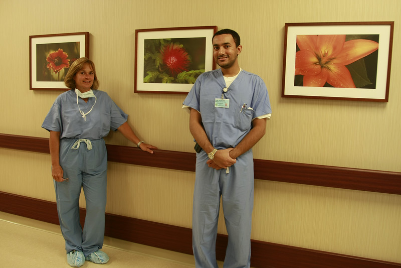 Dr. Vicki Athens and Dr. Laal Zada at South Shore Hospital in front of images donated by Vicki Athens