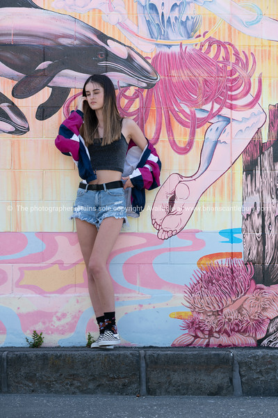 Teenager in front of street art Downtown Auckland. Model Released; Yes.