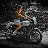 Young woman in casual clothing on classic motorcycle     Model released; Yes.